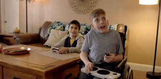 Child using xbox adaptive controller